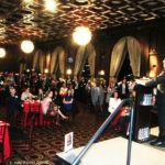 Jerome Fishkin at the podium with the reception ballroom