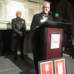 Jim McBride at the podium with Frank Bizzarro in the background