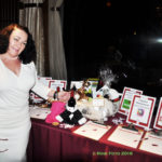 Kimberly Hathaway at the silent auction table