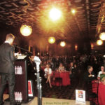 Okan Sengun at the podium with the reception ballroom