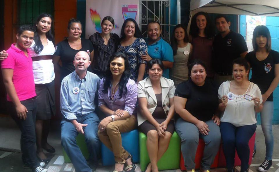 Ana Montano, front row right, meets in El Salvador with ASPIDH Arco Iris.